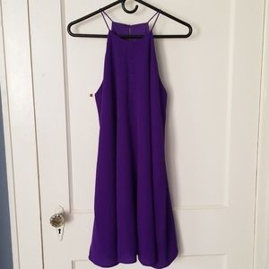 Purple sleeveless dress.